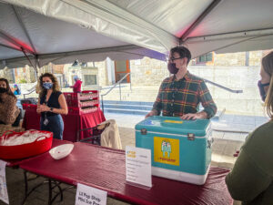 Staff giving away ice cream at the UNIVERSITY LIFE CAMPUS GRAB & GREET TREASURE HUNT