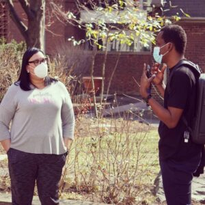 A student talking with a staff member at the GIC for Spring Stay
