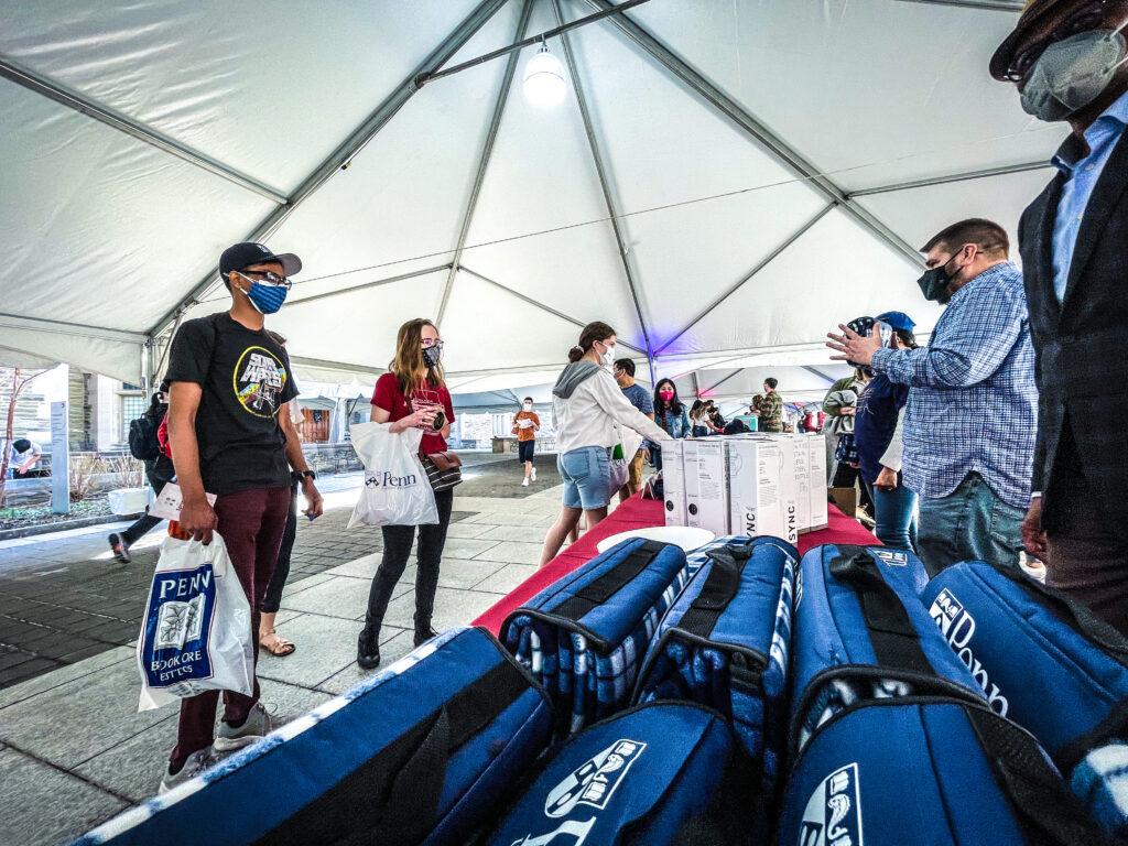 Students picking up swag at the UNIVERSITY LIFE CAMPUS GRAB & GREET TREASURE HUNT