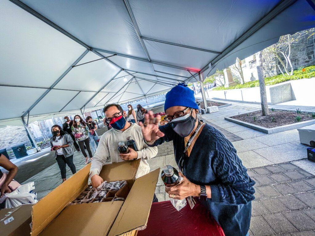 Staff giving away water bottles at the UNIVERSITY LIFE CAMPUS GRAB & GREET TREASURE HUNT