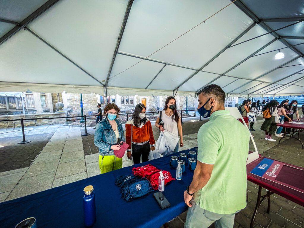 Students picking up giveaways at the UNIVERSITY LIFE CAMPUS GRAB & GREET TREASURE HUNT