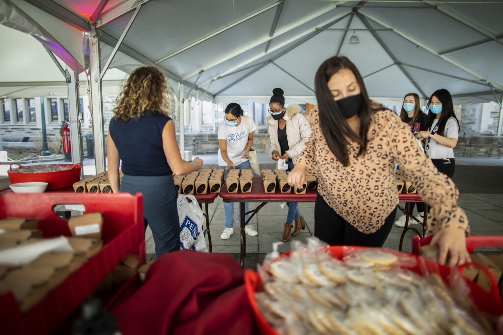 Staff giving away cookies at the UNIVERSITY LIFE CAMPUS GRAB & GREET TREASURE HUNT