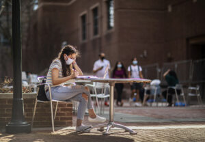 Student studying on Locust Walk during Spring Stay