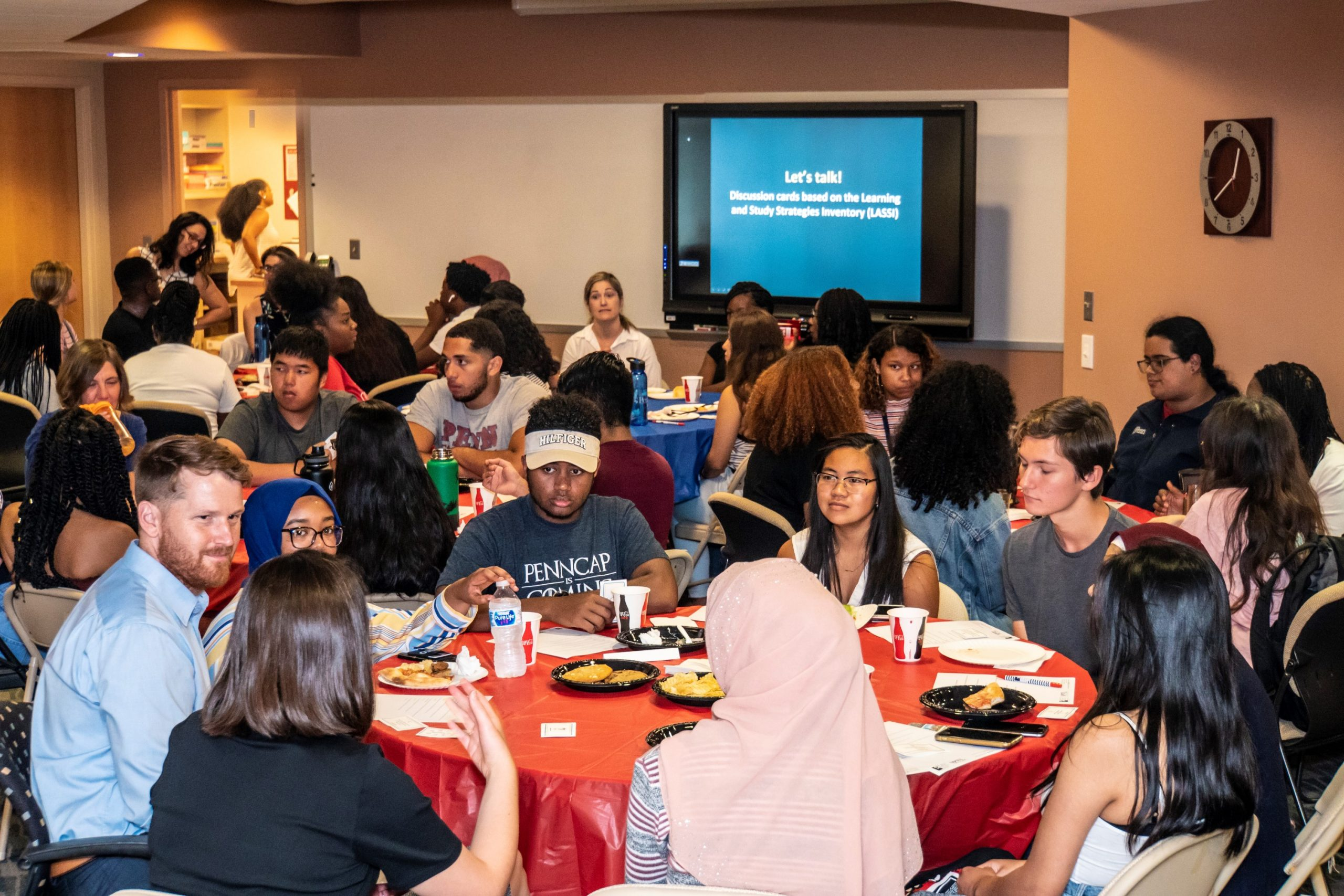Ryan Miller (left front) meets with students in August 2019, when the Weingarten Center collaborated with PennCAP to host students participating in the Pre-Freshman Program. (Image: Steve McCann)