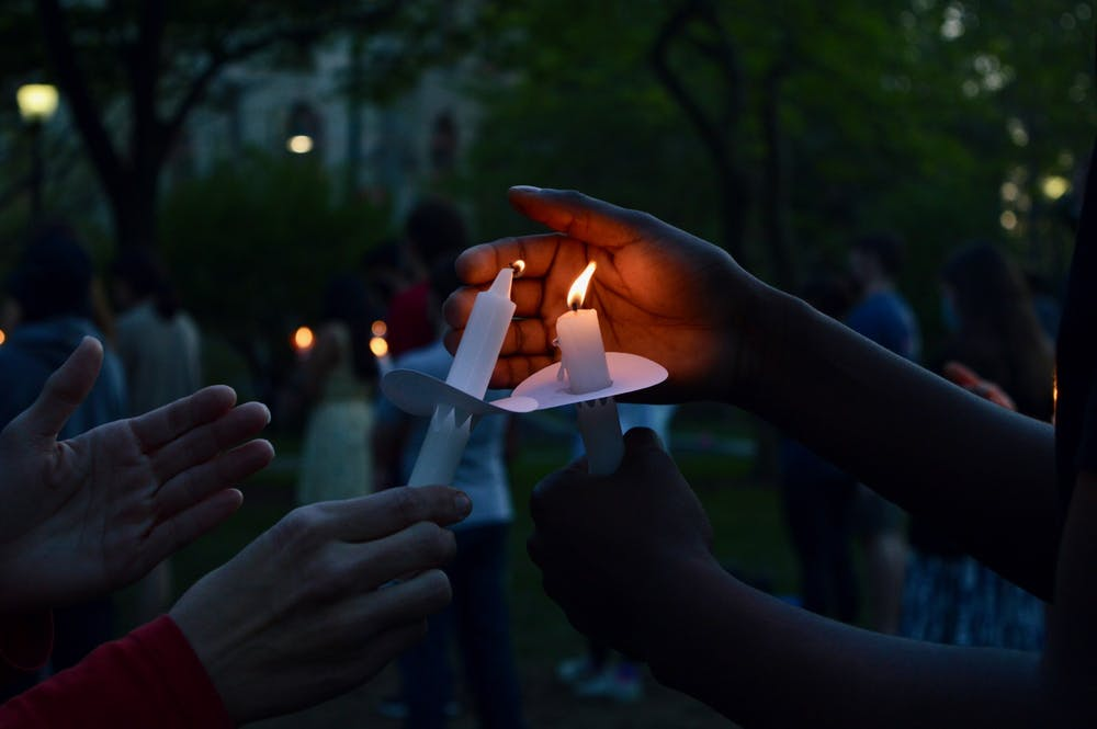 """Penn Democrats, the Pan-Asian American Community House, the Spiritual and Religious Life Center, and Amnesty International at Penn hosted """"Vigil for the Victims of Gun Violence"""" on April 20. Credit: Maya Pratt"""